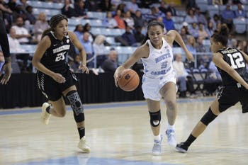 Junior guard Stephanie Watts (5) charges up the court during a game against Wake Forest in Carmichael Arena on Thursday, Jan. 17, 2019. UNC won 84 to 61.