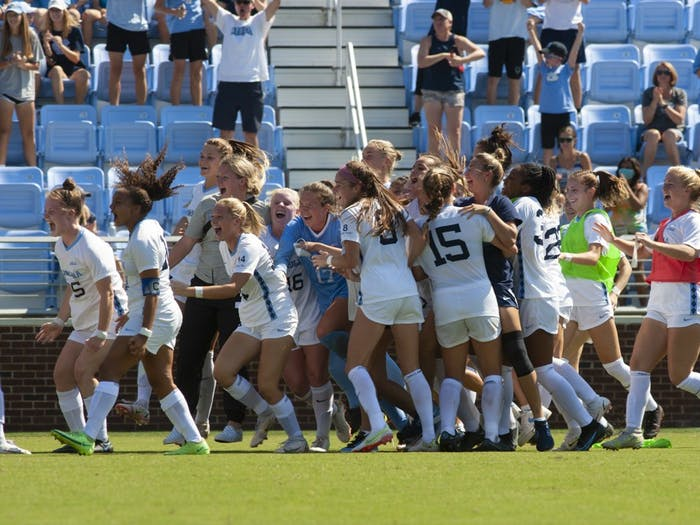 UNC women's soccer team celebrates their win against Stanford on Sept. 5. UNC beat Stanford in overtime 2-1.
