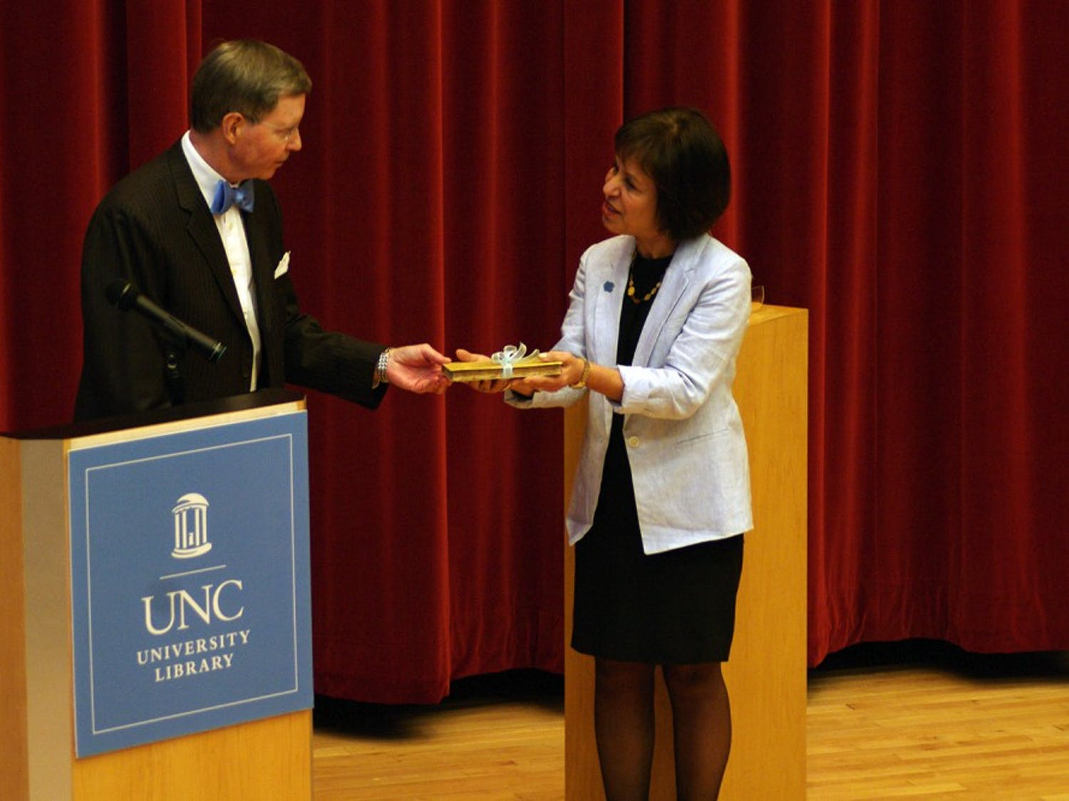 Chancellor Carol Folt accepted the 7 millionth book in the University of North Carolina's library, which was a gift from John Wesley and Anna Hodgins Hanes Foundation. Chancellor Carol Folt accepted the 7 millionth book in the University of North Carolina's library, which was a gift from John Wesley and Anna Hodgins Hanes Foundation, on Thursday Evening at the FedEx Global Education Center