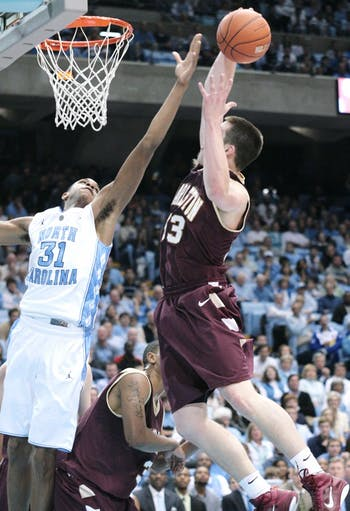 Sophomore forward John Henson goes up for a block against a Cougar. He was the first to score in a game-sealing 22-8 run for the Tar Heels.