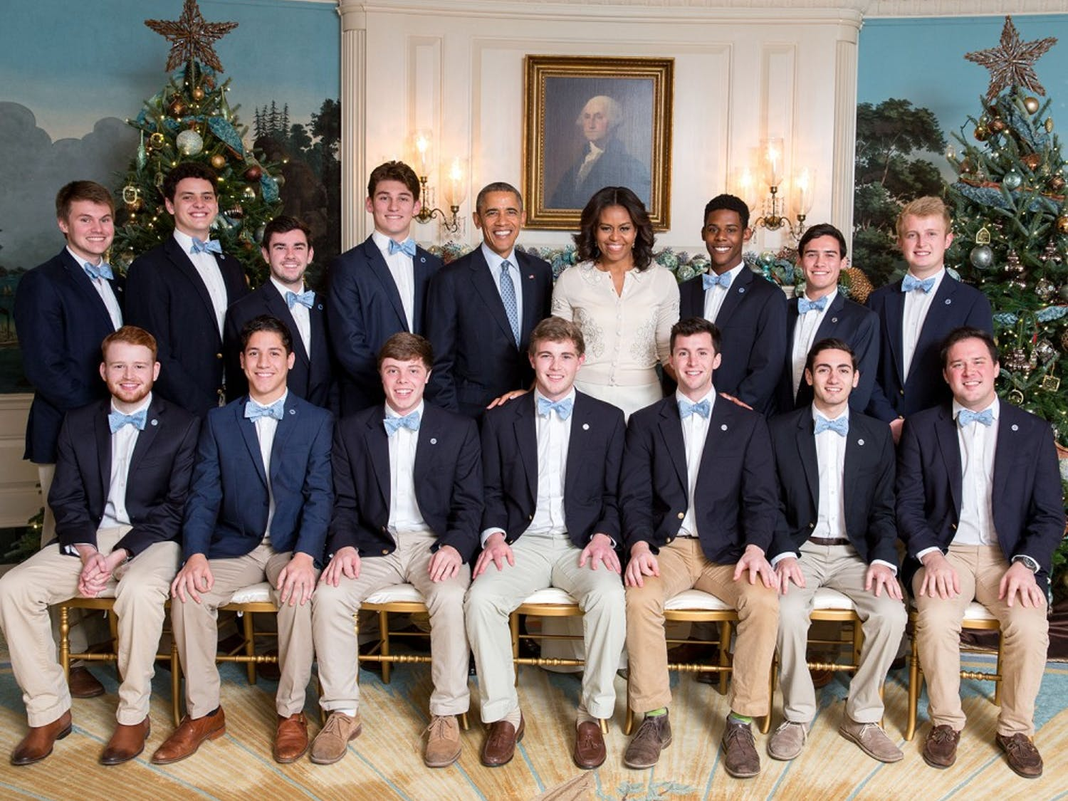 President Barack Obama and First Lady Michelle Obama join the UNC (University of North Carolina) Clef Hangers for a group photo and listen to them perform in the Diplomatic Reception Room prior to Christmas holiday EOP Reception #1 at the White House, Dec. 15, 2015. (Official White House Photo by Chuck Kennedy)This photograph is provided by THE WHITE HOUSE as a courtesy and may be printed by the subject(s) in the photograph for personal use only. The photograph may not be manipulated in any way and may not otherwise be reproduced, disseminated or broadcast, without the written permission of the White House Photo Office. This photograph may not be used in any commercial or political materials, advertisements, emails, products, promotions that in any way suggests approval or endorsement of the President, the First Family, or the White House.
