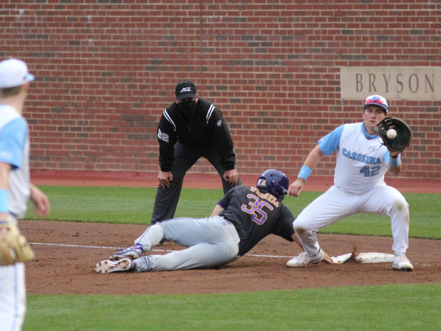 UNC sophomore left-handed pitcher Will Sandy (41) attempts to pick off ECU outfielder Bryson Worrell at first base during the Tar Heels' game against East Carolina University at Boshamer Stadium on March 23, 2021. The Tar Heels defeated the Pirates 8-1.