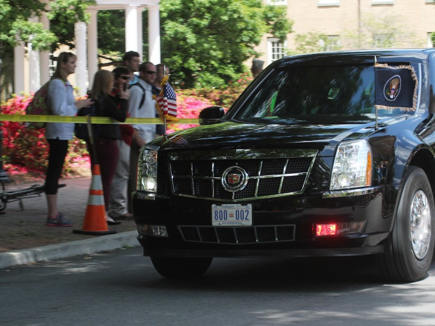 The motorcade on its way to Memorial Hall.