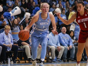 UNC senior guard Taylor Koenen (1) dribbles the ball upcourt during a game against NC State on Thursday, Jan. 9, 2020. UNC broke N.C. State's undefeated streak with a score of 66-60.