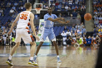 UNC senior guard Brandon Robinson (4) passes the ball in the second round of the 2020 New York Life ACC Tournament held in the Greensboro Coliseum in Greensboro, N.C., on Wednesday, March 11, 2020. UNC lost 81-53 to Syracuse.