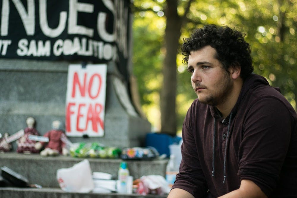 <p>Tim Osborn, physics graduate student, was one of many community members to spend the night of Aug 24 at the monument.</p>