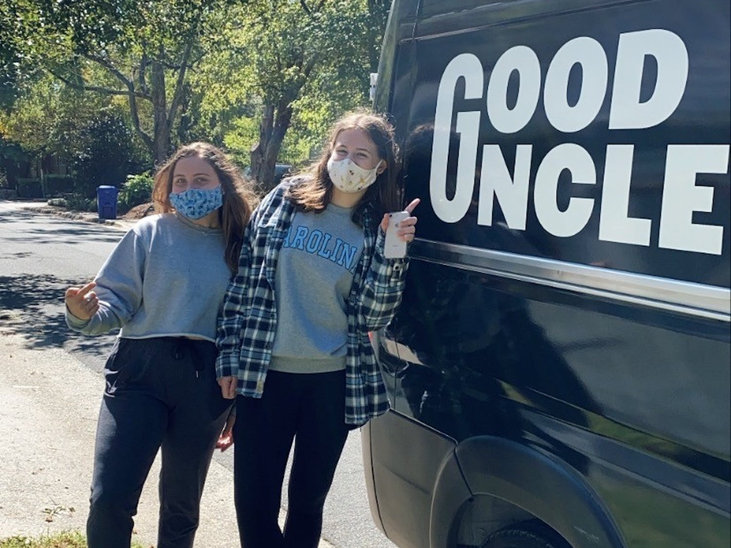 Seniors Samantha Savage (Left) and Rachael Stone (Right) pick up brunch from a Good Uncle food truck. Photo courtesy of Caroline Jones.