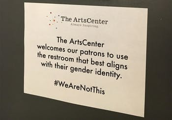 """The ArtsCenter hangs signs in the bathrooms stating """"#WeAreNotThis"""" in opposition to H.B. 2(courtesy ofPatrick Phelps-Mckeown)."""