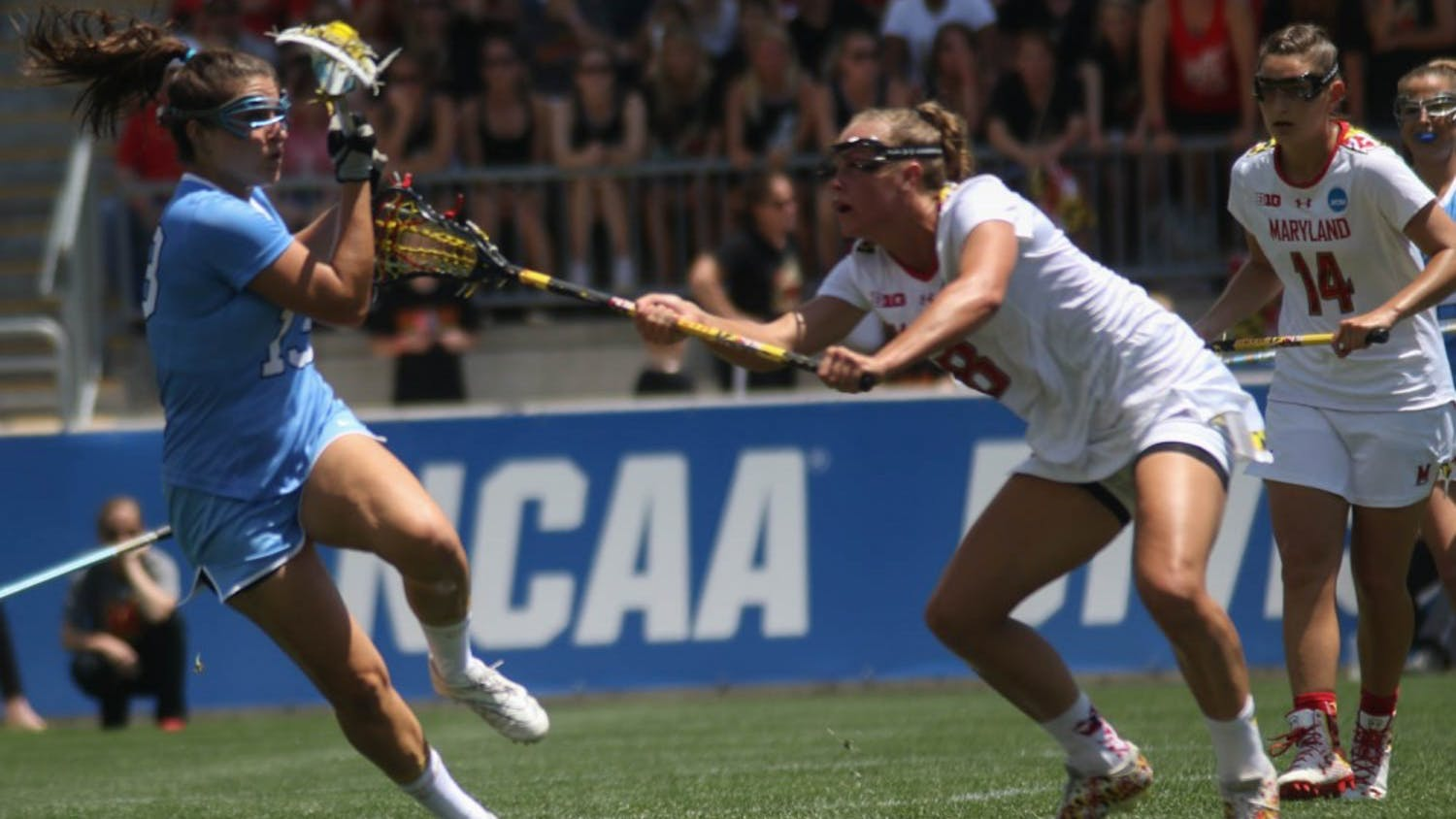 UNC midfielder Sammy Jo Tracy (13) pulls the ball back from a Maryland defender. The North Carolina women's lacrosse team defeated Maryland 13-7 to capture the NCAA championship on Sunday at Talen Energy Stadium in Chester, PA.