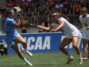 UNC midfielder Sammy Jo Tracy (13) pulls the ball back from a Maryland defender.The North Carolina women's lacrosse team defeated Maryland 13-7 to capture the NCAA championship on Sunday at Talen Energy Stadium in Chester, PA.