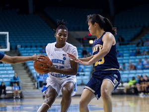 First-year guard Nia Daniel (32) dodges Navy players in the women's basketball game against Navy in the Carmichael Arena on Monday, Nov. 11, 2019. UNC won 80-40.