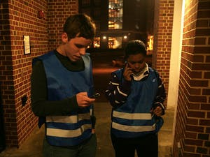 McKinney Brown, left, and Ariel Eure call the SafeWalk dispatcher on January 19, 2010.
