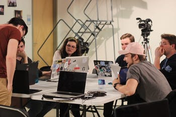 """The production team for UNC Student Television's """"Fix,"""" a musical that will be submitted to the 2020 Academy Awards, works on the music and script for the film during a workshop session on Jan. 8. 2019."""