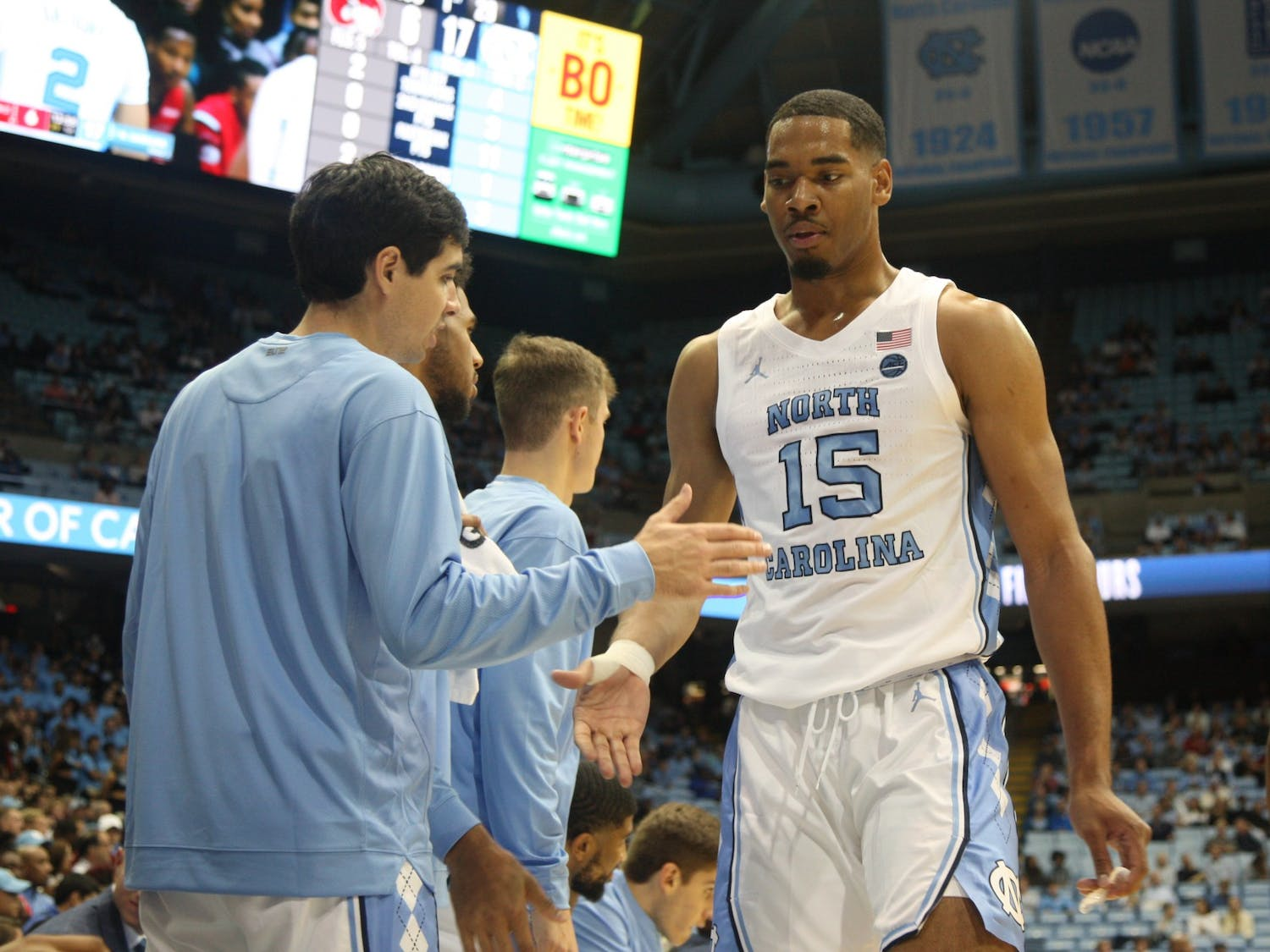 Junior guard Garrison Brooks (15) daps up his teammates during the exhibition game against Winston Salem State in the Smith Center on Friday, Nov. 1, 2019. UNC beat WSSU 96-61.