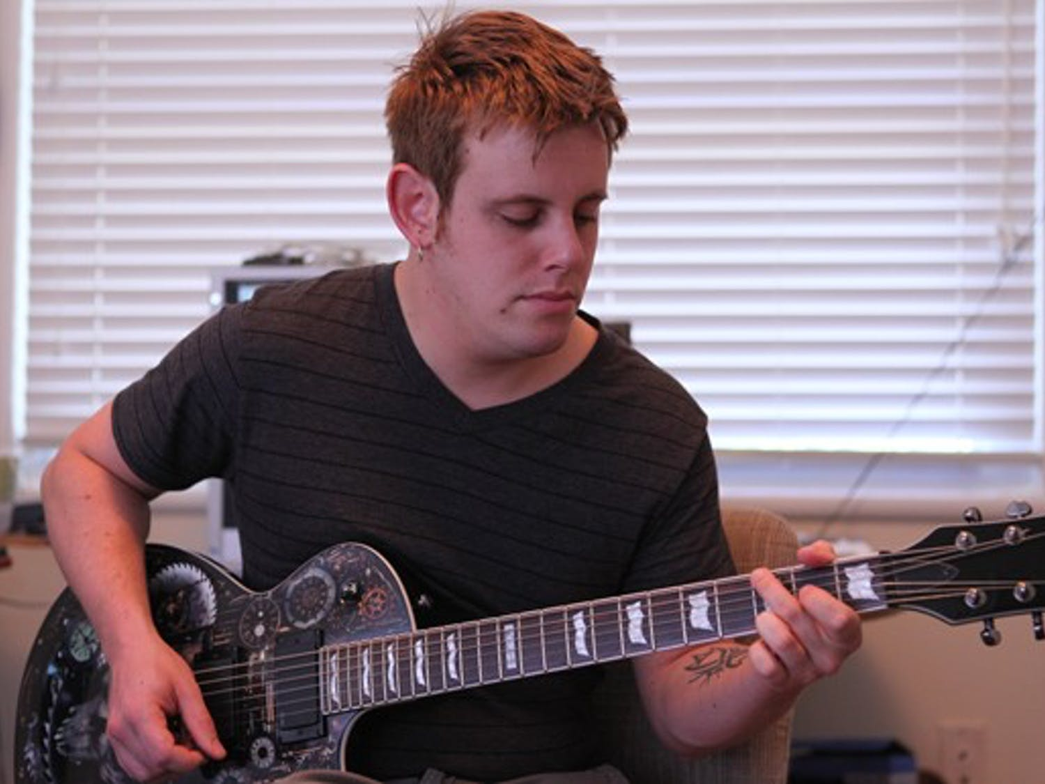 James Carlson practices on his newest guitar. DTH/Stephen Mitchell