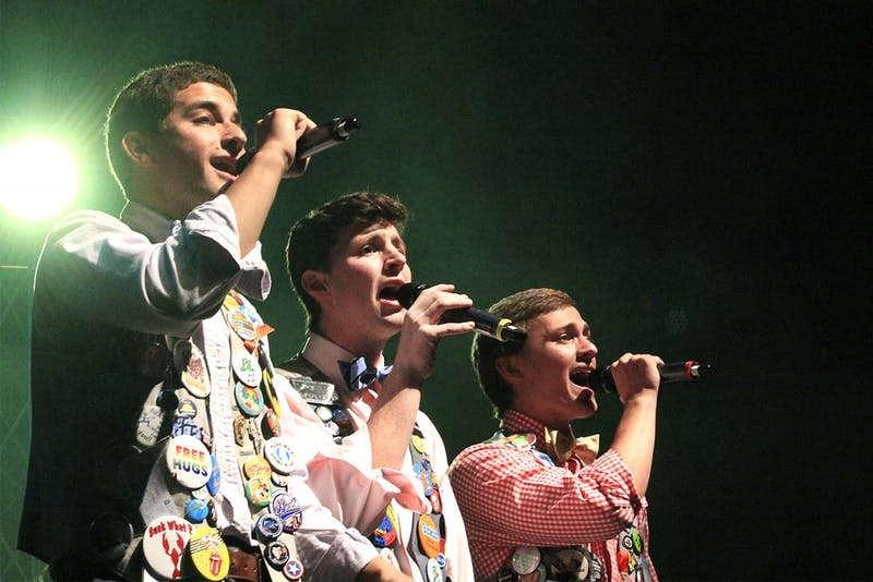 Jeff Popkin, Jason Hill, and Miles Herr (from left to right), members of the oldest A Capella group at UNC Chapel Hill, The Clef Hangers, perform their Fall Concert in Memorial Theater.