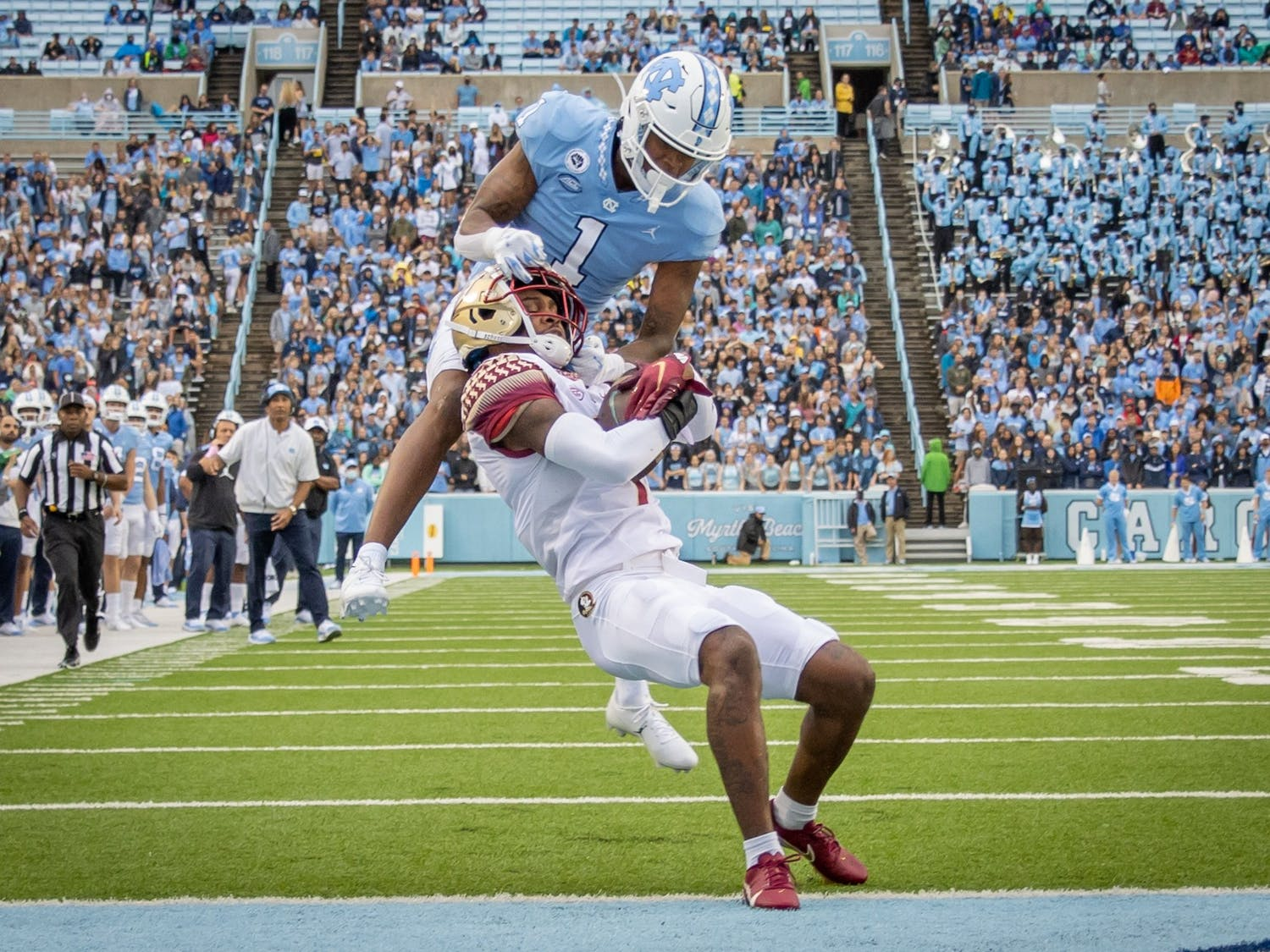 FSU sophomore defensive back Jarrian Jones (7) intercepts a long pass intended for UNC sophomore wide receiver Khafre Brown (1) during the Tar Heels' home football matchup in Kenan Memorial Stadium on Oct. 9, 2021, against the Florida State Seminoles. FSU won 35-25.
