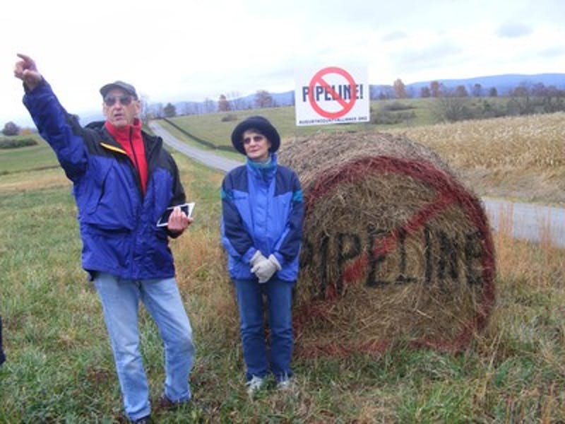 "Fred and Bonnie Powell stand on their Augusta County, Va., farmland that lies on the proposed route of the 550-mile Atlantic Coast Pipeline from West Virginia to eastern North Carolina, on November 1, 2014. The Powells are not allowing Dominion Resources to survey for the right-of-way. ""We re not against pipelines but the location for this is terrible,"" Fred Powell said. (Sean Cockerham/MCT)"