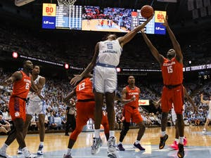 UNC's freshman forward Armando Bacot (5) attempts to gain possession of the ball during a game against Clemson at the Dean Smith Center on Saturday, Jan. 11th, 2020. Clemson defeated UNC for the first time in Chapel Hill 79-76.