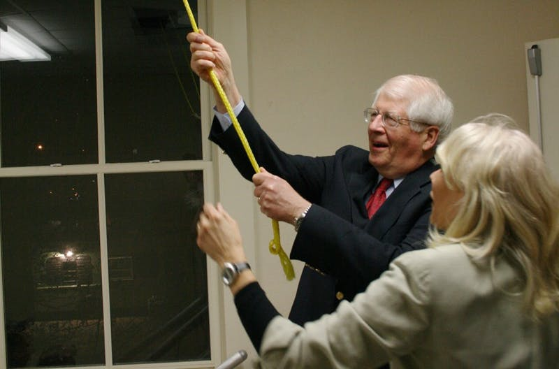 Congressman David Price rings the Carrboro City Hall bell, remarking how he hasn't rung this bell in a long, long time. His contribution made up one of a hundred chimes marking the beginning of the centennial celebration.
