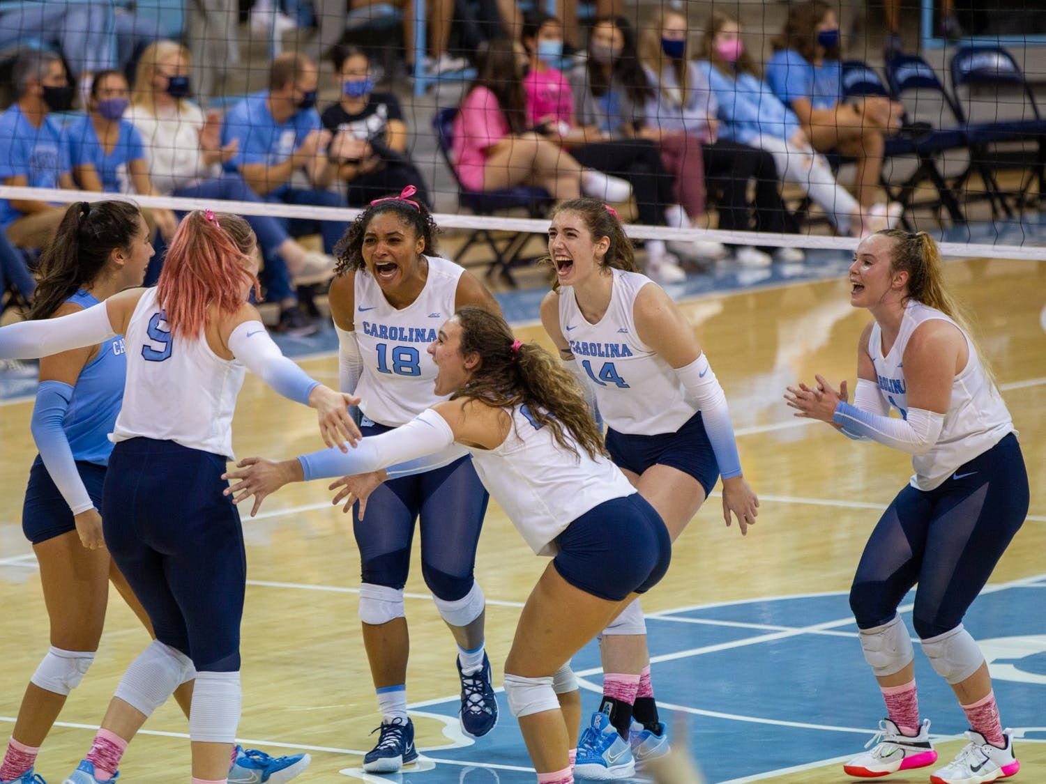 UNC women's volleyball players celebrate after scoring a point at the game against Duke on Oct. 22 at Carmicahel Arena. UNC won 3-0.