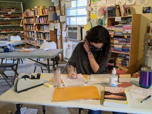 A volunteer answers a book request from an incarcerated individual. Photo courtesy of Liz Schlemmer.