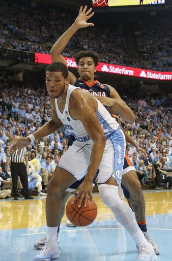 North Carolina forward Kennedy Meeks (3) attempts to work away from a Virginia defender under the basket Saturday.