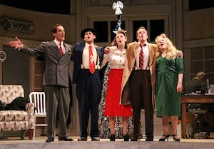 """The cast of """"It's a Wonderful Life: A Live Radio Play"""" closes the Tuesday dress rehearsal performance by singing the ballad """"Auld Lang Syne."""""""