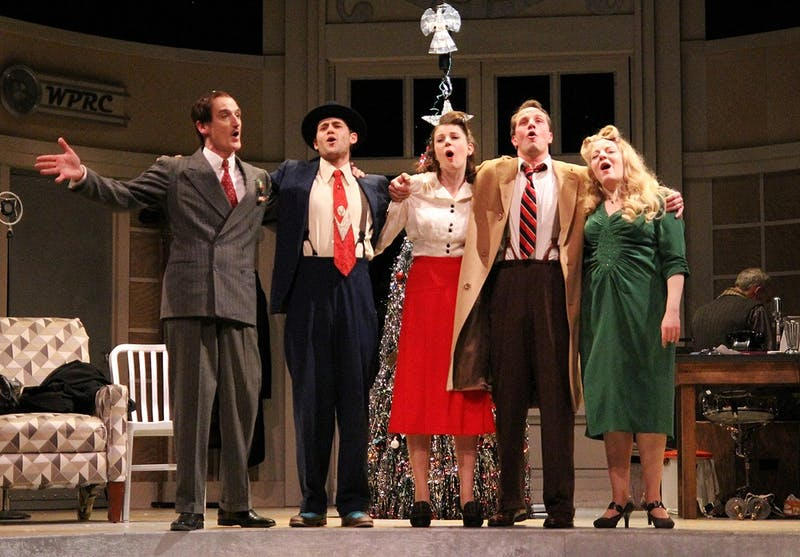 "The cast of ""It's a Wonderful Life: A Live Radio Play"" closes the Tuesday dress rehearsal performance by singing the ballad ""Auld Lang Syne."""