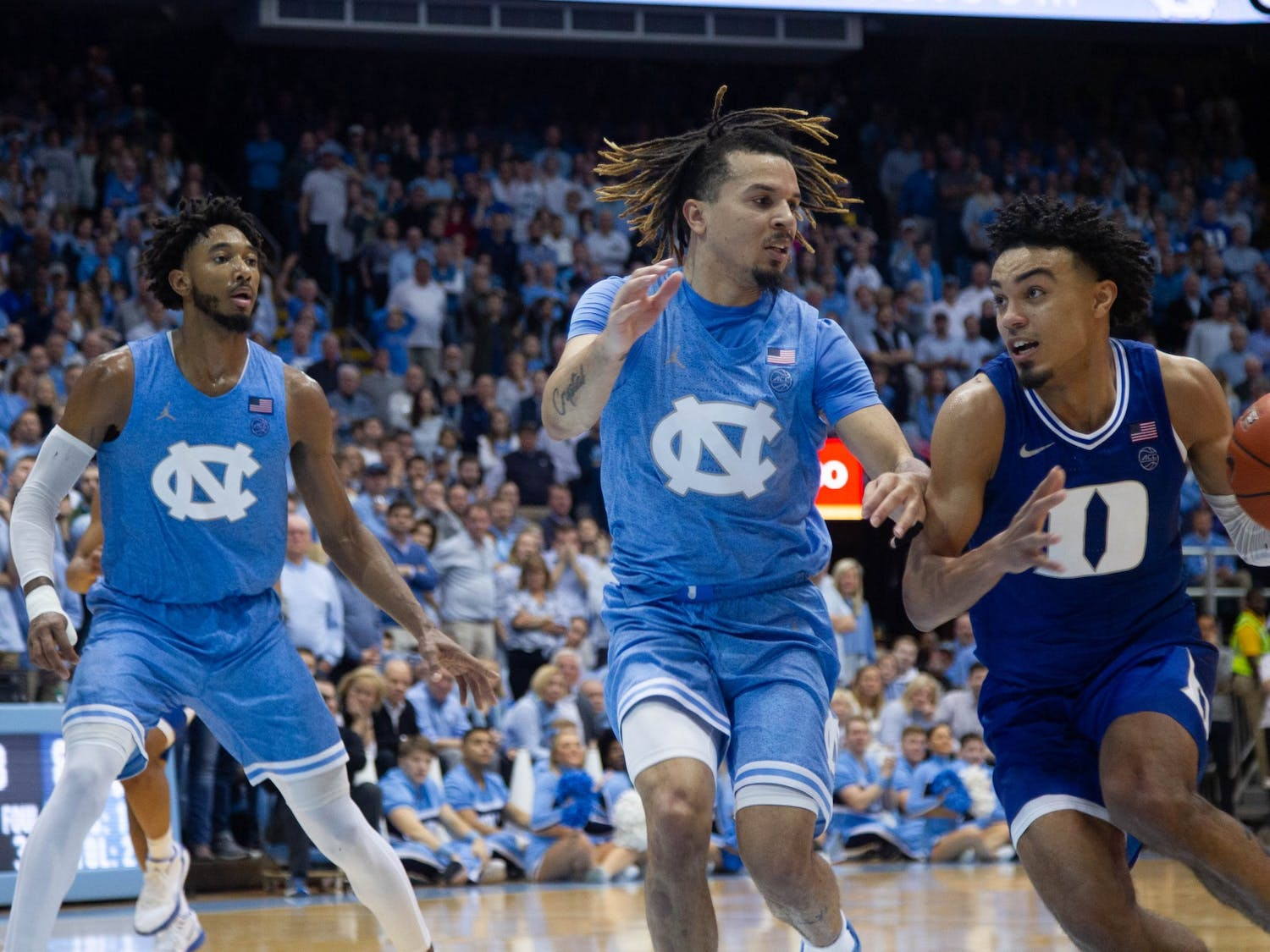 Duke's sophomore guard Tre Jones (3) and UNC's first-year guard Cole Anthony (2) collide during the game against Duke in the Smith Center on Saturday, Feb. 8. 2020. UNC lost to Duke 98-96.