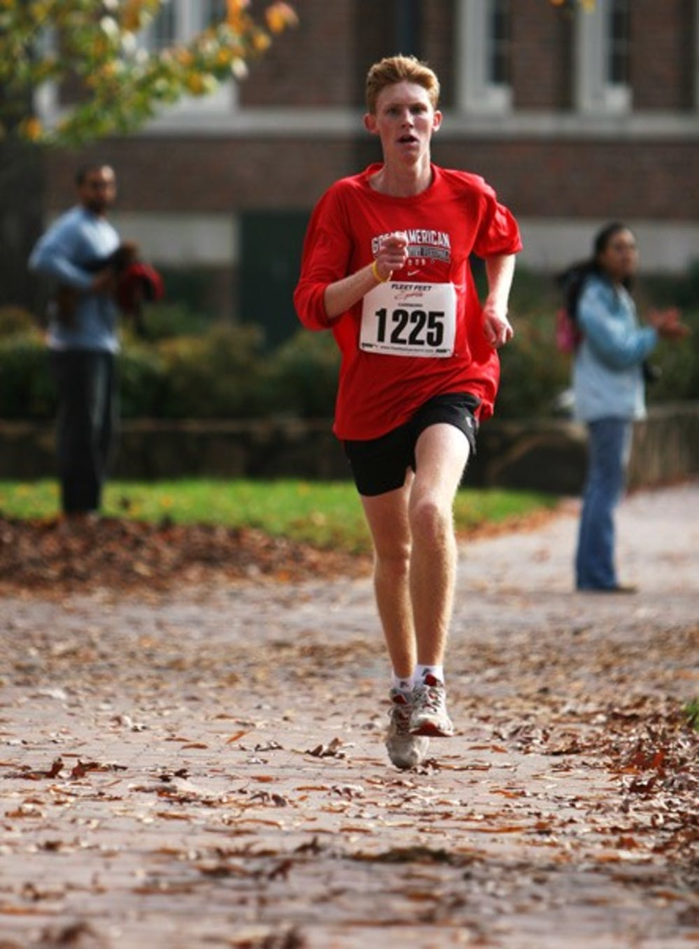 Greg Barnes, the first-place finisher, comes around the bend in one of the largest road races ever run on campus. DTH/Tyler Bent