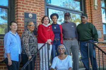 Members of the Carrboro Truth Plaque Task Force and Board of Alderman stand beside the a newly unvieled truth plaque dedicated to bringing light to the origin of Carrboro. The plaque was unvieled Tuesday, April 16, 2019, and details how the town began and how it came to be named Carrboro after Julian S. Carr, a prominent figure in the white supremicist movement and influential industrialist.