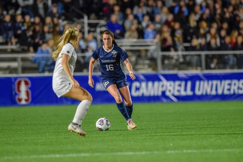 Defender Julia Ashley (16) dribbles the ball past a defending opponent during UNC's match against Georgetown in the Women's College Cup semifinals on Friday, Nov. 30 2018 at Sahlen's Stadium at WakeMed Soccer Park in Cary. UNC won 1-0.