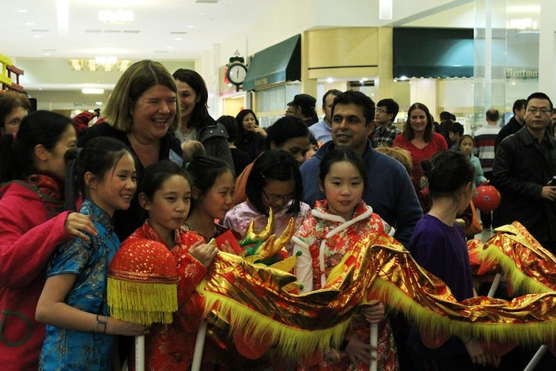 Chapel Hill Town Mayor, Pam Hemminger, celebrates the Chinese New Year at Univeristy Place with Lantern Festival participants.