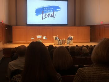 (From left) John Wilson and Tim Sullivan converse about their time as UNC Undergraduates during Thursday's Eve Carson Lecture on Thurs, Feb. 27, 2020.