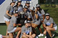 UNC women's tennis players pose with their trophy after winning the ACC Tennis Tournament in Cary, NC on Sunday April 21, 2019. UNC beat Duke 4-2.