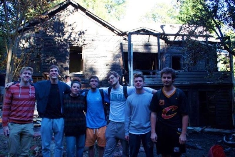 Residents of 416 Pittsboro Street pose in front of their house before it burned down. Photo courtesy of Sam Gault.
