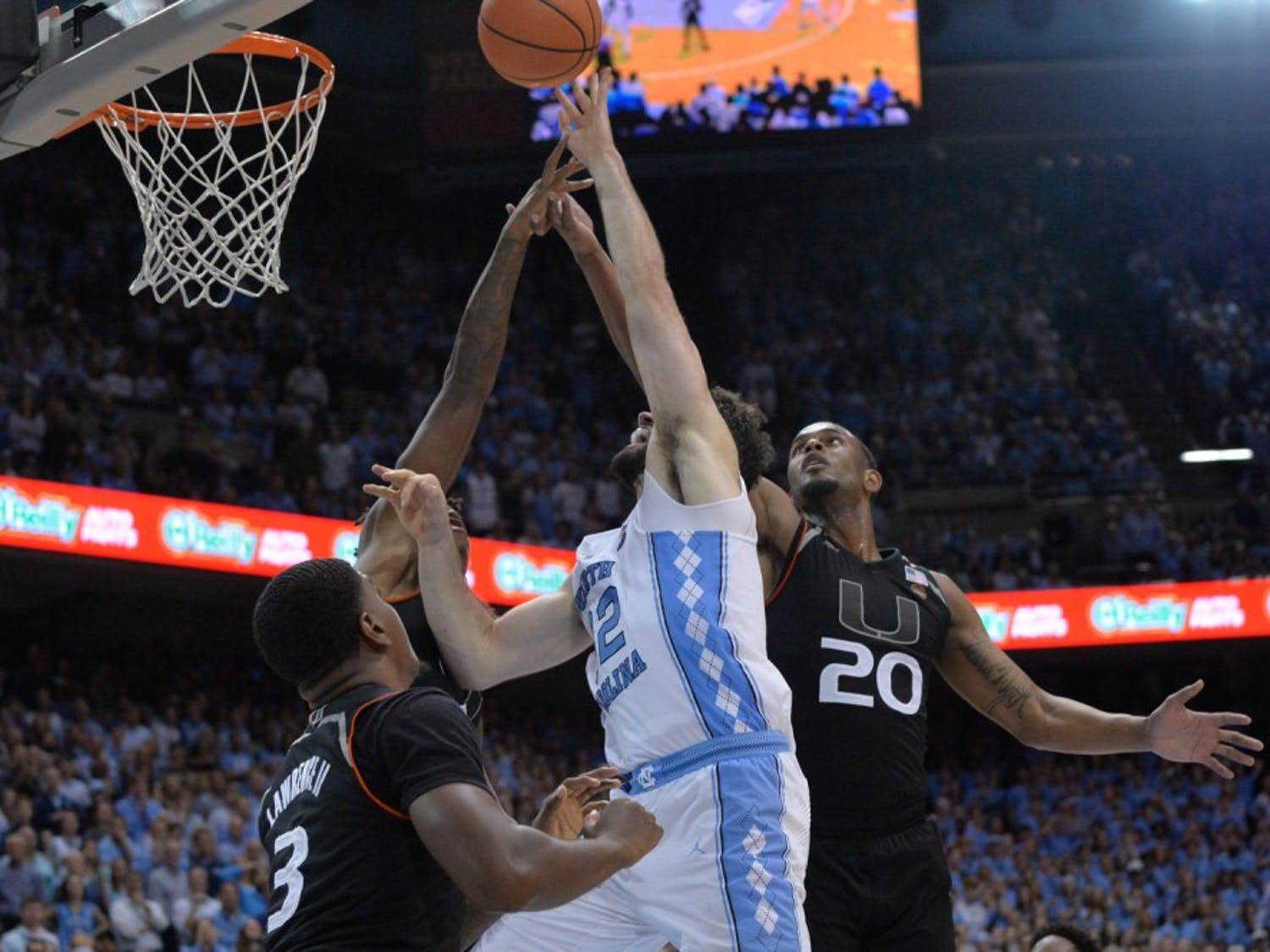 Junior forward Luke Maye (32) goes up for a shot between three Miami defenders on Feb. 27 at the Smith Center.
