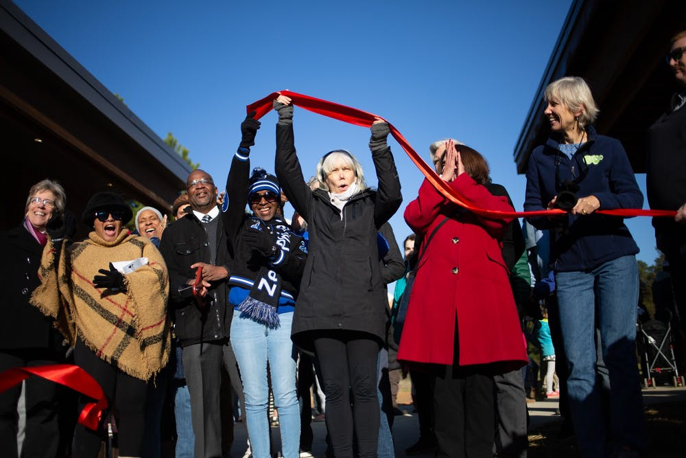 <p>Local community members and leaders assemble for the ribbon-cutting at the recently opened &nbsp;Martin Luther King Jr. Park on Monday, Jan. 20, 2020. A crowd gathered for the park's ribbon-cutting two years after the initial groundbreaking.</p>
