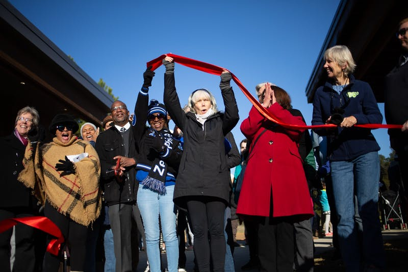 Local community members and leaders assemble for the ribbon-cutting at the recently opened  Martin Luther King Jr. Park on Monday, Jan. 20, 2020. A crowd gathered for the park's ribbon-cutting two years after the initial groundbreaking.