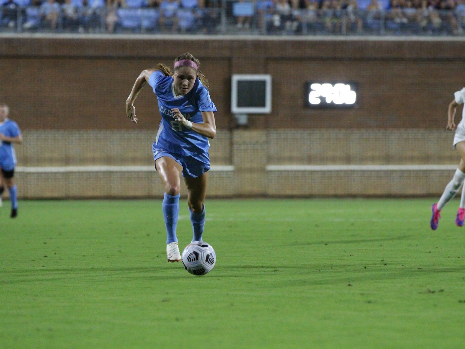 UNC Sophomore forward Emily Moxley (8) runs with the ball during the Duke vs UNC soccer game on Sept. 17. The Tar Heels lost 1-0.