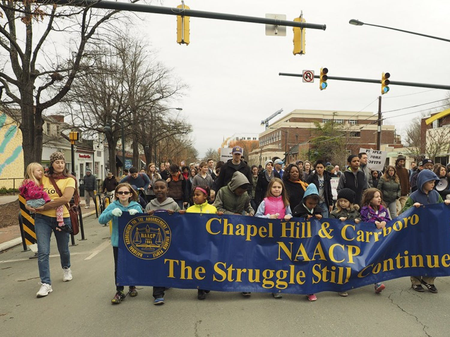 Local Chapel Hill/Carrboro youth lead the march from Peace and Justice Plaza to First Baptist Church during Monday's MLK Jr Day Celebration.