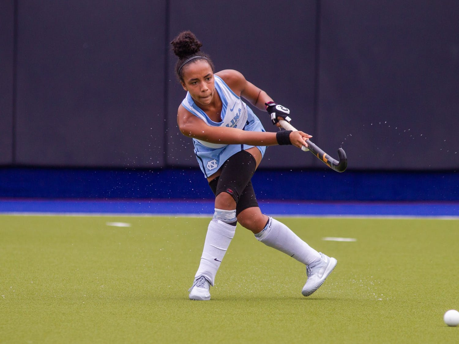 First-year midfielder Kiersten Thomassey (35) strikes the ball during the game against Virginia on Monday, Oct. 12th, 2020 at Shelton Stadium. UNC won 2-1.
