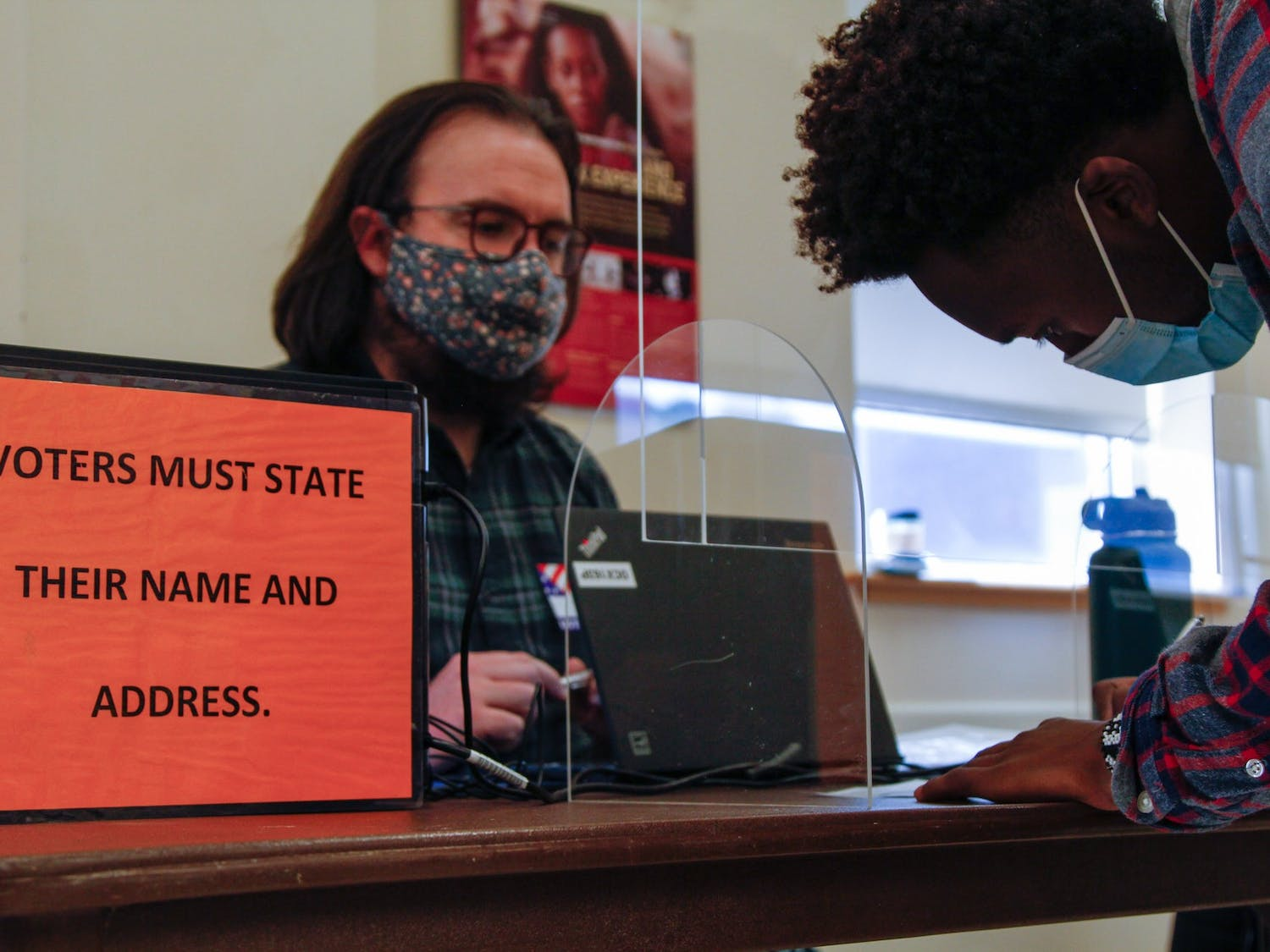 A student at UNC-Chapel Hill writes down their information in order to vote in the 2020 general election on Nov. 3, 2020 at the Stone Center polling location.