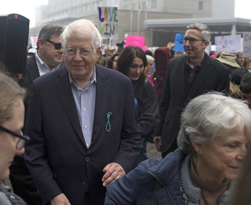 North Carolina Congressman David Price marches with protestors as they make their way through Raleigh during the 2016 Women's March in protest of the inauguration of Donald Trump as the 45th president of the United States.