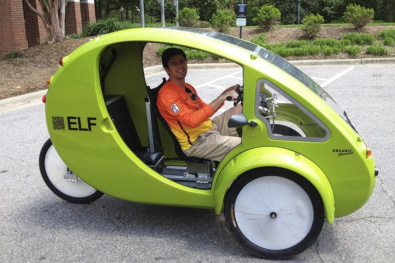 Patrick White, a senior business major, tests out an alternative form of transportation, a one-person-electrical bicycle called an ELF, in the parking lot of Kenan-Flagler on Monday afternoon.