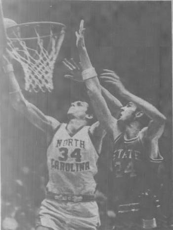 UNC senior forward Bobby Jones battles N.C. State's Tommy Burleson for a rebound in a game during the 1973-1974 season.