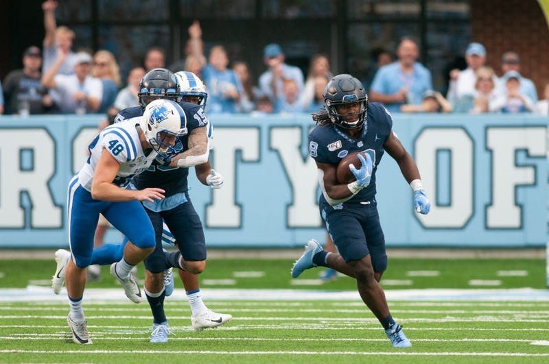 Junior running back Michael Carter (8) runs the ball in the homecoming game against Duke on Saturday, Oct. 26, 2019 in Kenan Memorial Stadium. UNC defeated Duke 20-17 for the first time in three years.