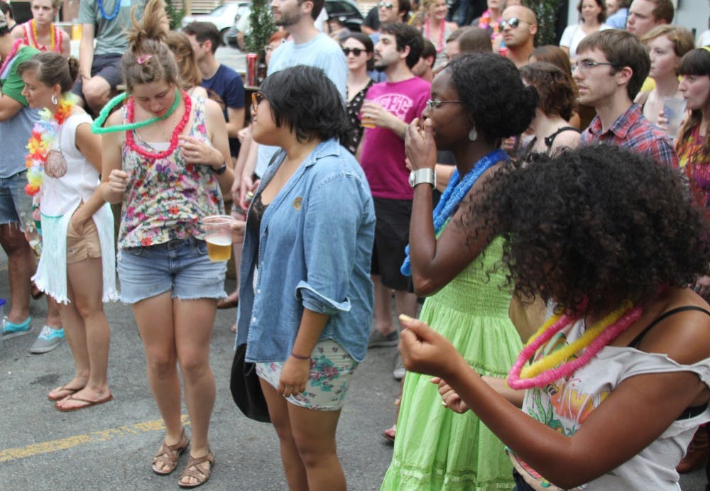 <p>People at the barbeque dance along to music by the band Flesh Wounds.</p>
