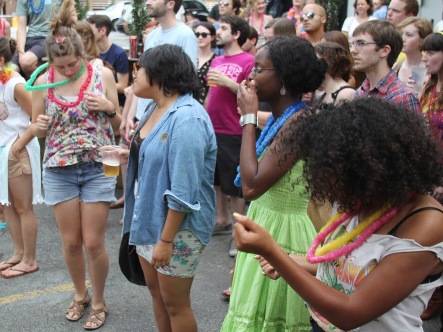 People at the barbeque dance along to music by the band Flesh Wounds.